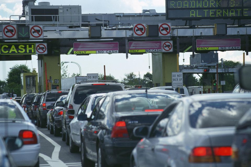 Cars lined up waiting to go through a toll booth in New York