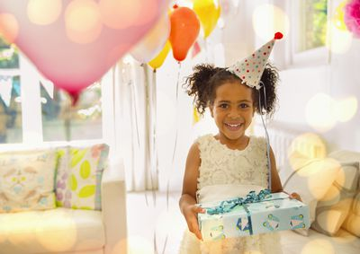 Free birthday meals to help you celebrate portrait smiling girl holding birthday gift bookmarktalkfo Choice Image