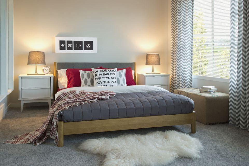 Contemporary bedroom wth chevron print curtains.