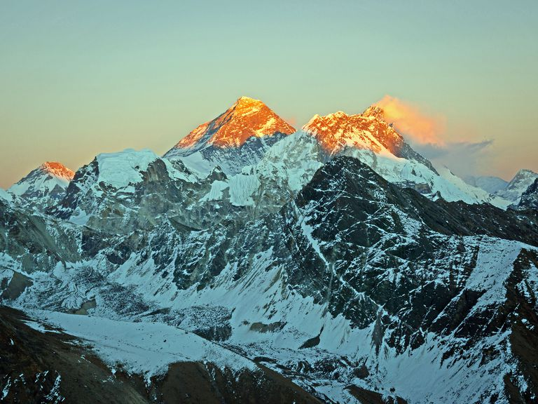Mount Everest, highest mountain in the world, and Lhotse bask in evening's last light.