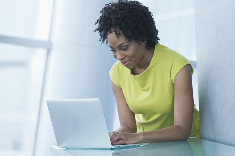 An African American woman reviews an applicant thank you letter following the interview.