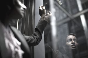 Reflection of business woman in window