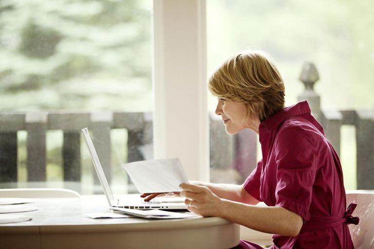 Woman Paying Bills On Computer