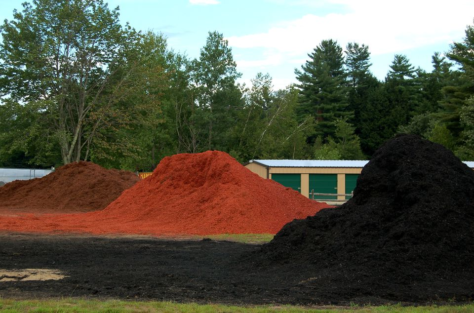 Image: mulch piles in three different colors.