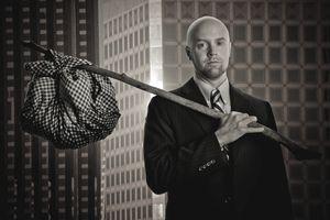 Hobo businessman with hobo stick and bundle