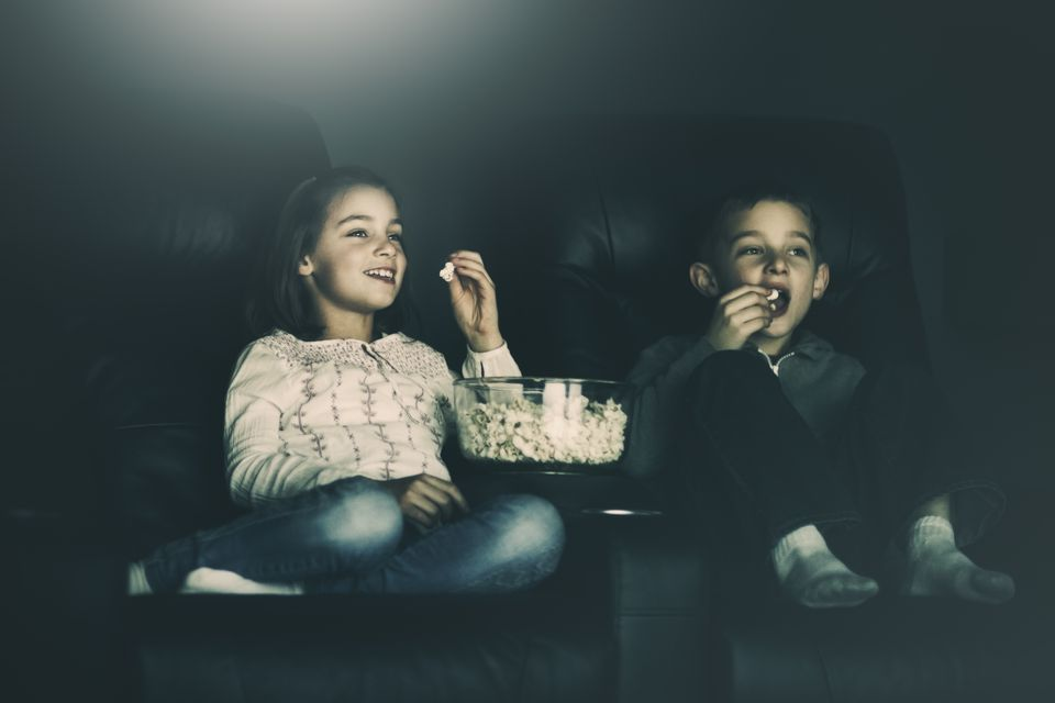 boy and girl watching a movie