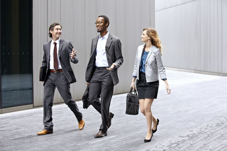 Business people walking on city street