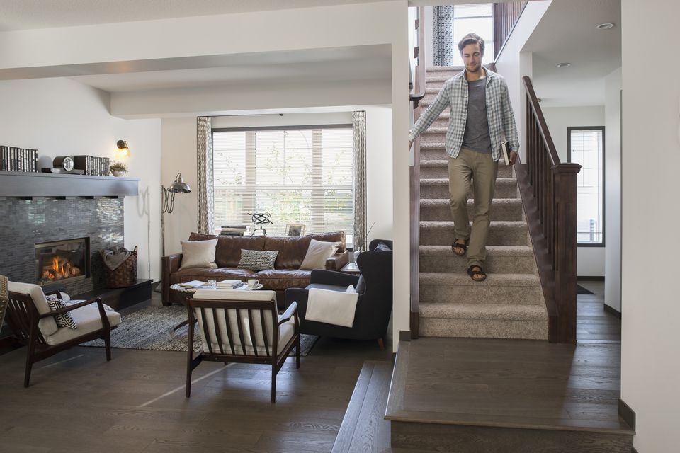 Man descending staircase in house