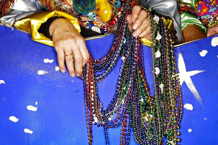 Ruby Gallagos holds a handful of beads before a Mardi Gras parade. (Justin Sullivan/Getty Images)