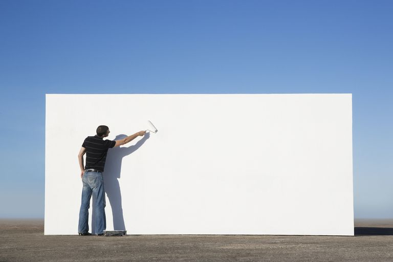 Man paints a wall