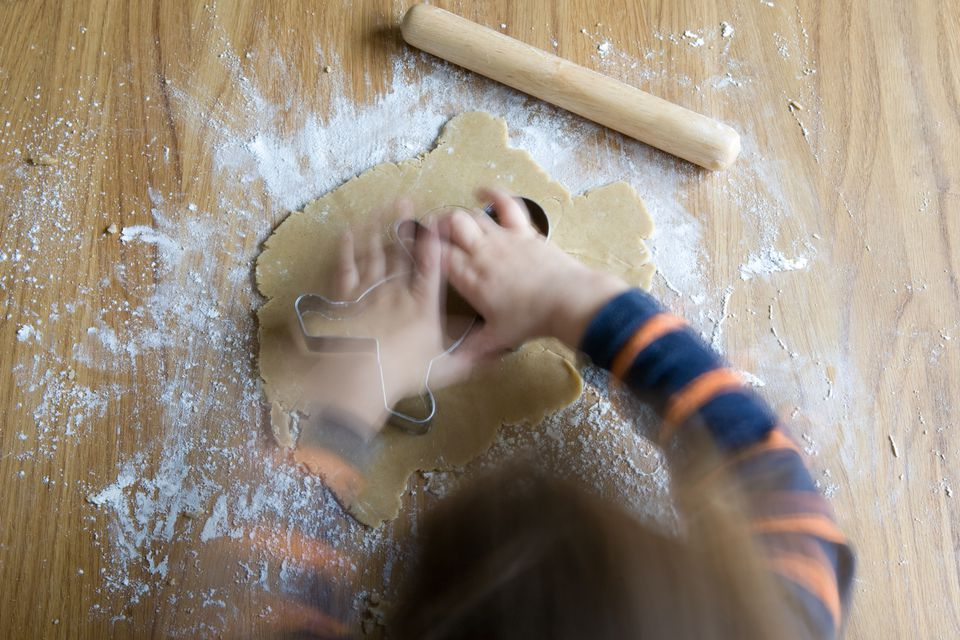 toddler making gingerbread man