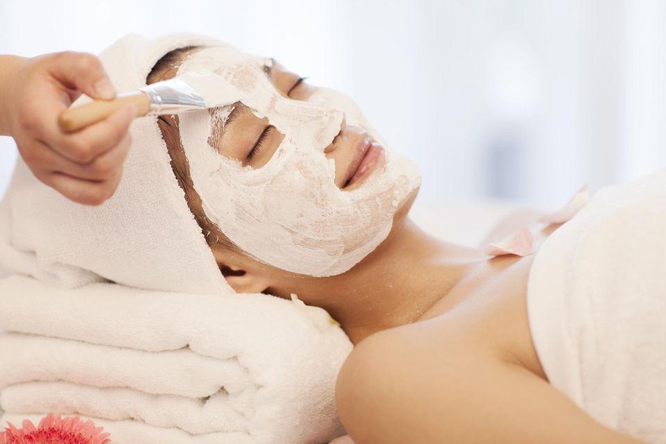 A woman having facial spa treatment