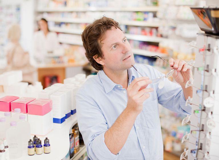 Customer trying in prescription eyeglasses in drug store