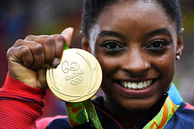 Simone Biles with her gold medal at the Olympics