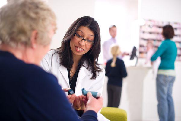 pharmacist explaining asthma inhaler