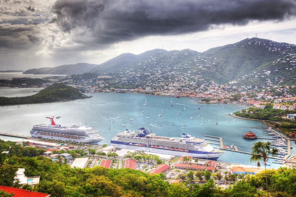 High Angle View Of Cruise Ships In River Against Mountains And Cloudy Sky