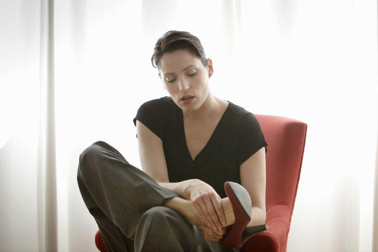 Woman rubbing her feet