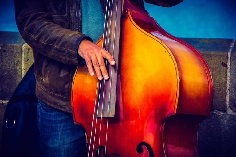 Man Playing Double Bass On Street