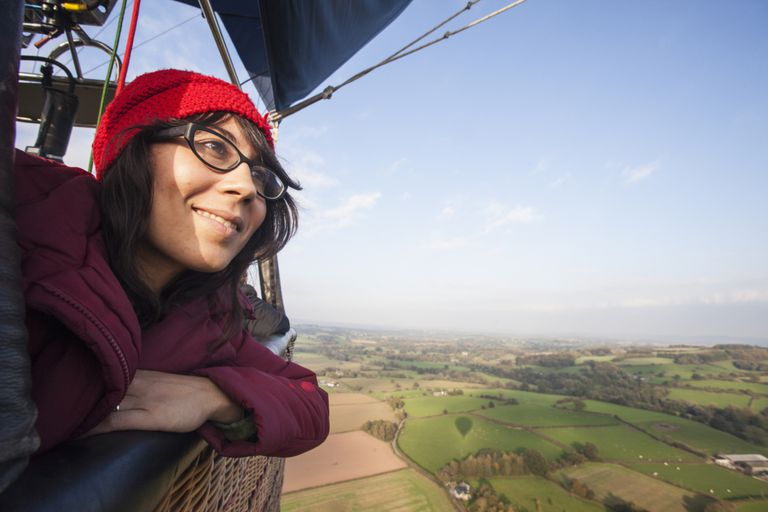 Woman in a hot air balloon, thankful for her increased Social Security amount.