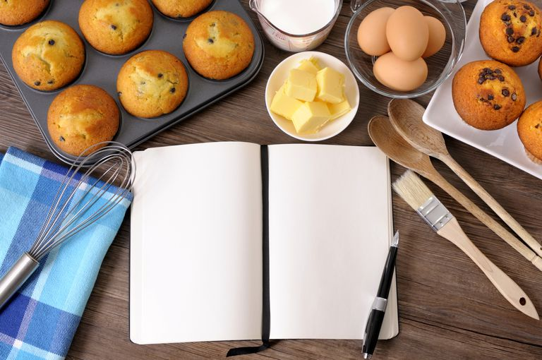 Image of a recipe book and ingredients, illustrating About.com's Recipe Contest List.