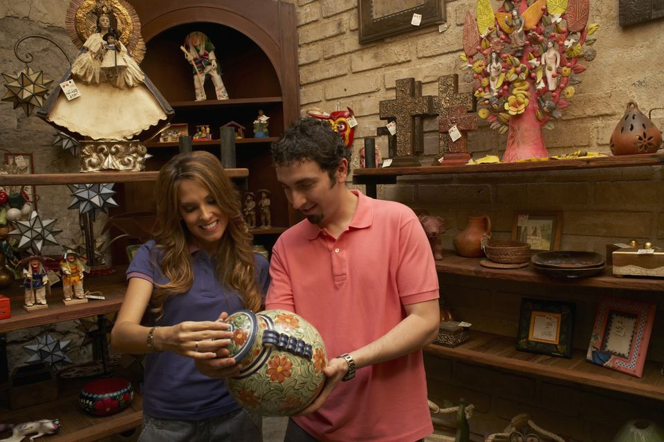 couple shopping at indoor flea market booth