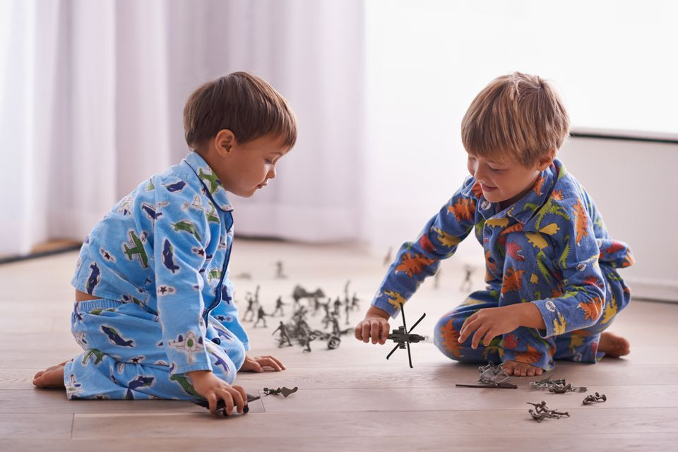 Kids playing with action figures