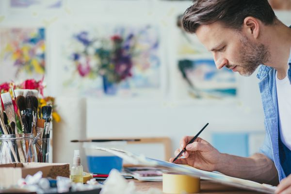 Man experiencing flow while painting.