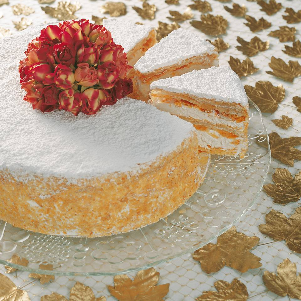 A millefoglie cake with zabaglione cream filling and almond-Savoiardi biscuit crunch on the outside