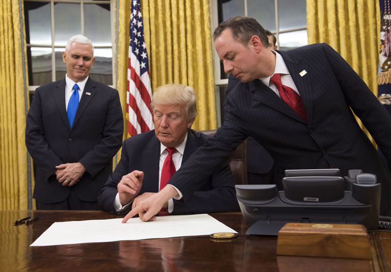 President Trump signing his first executive order
