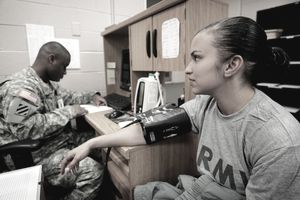 Army Sgt. Lana Sbitany,gets her blood pressure checked, part of the medical requirements she needs to be reassigned to active duty