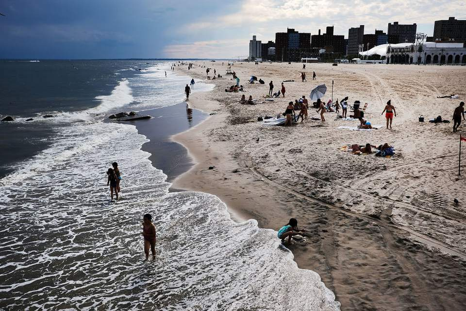New Yorkers Welcome First Day Of Summer At Coney Island