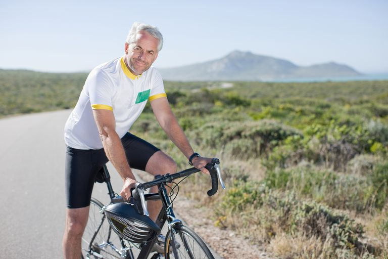 Man sitting on a bicycle.