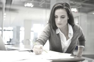 businesswoman working at open space desk