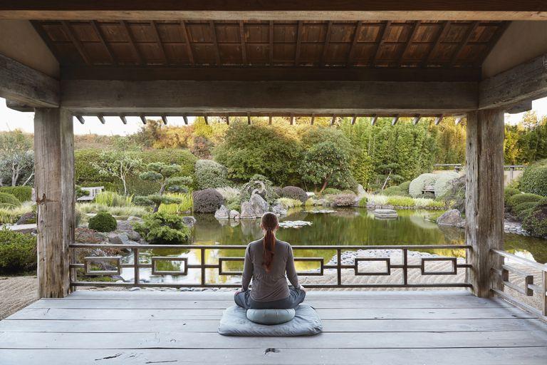Woman meditating on a patio