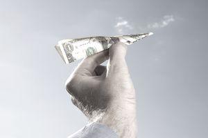 Man holding money airplane