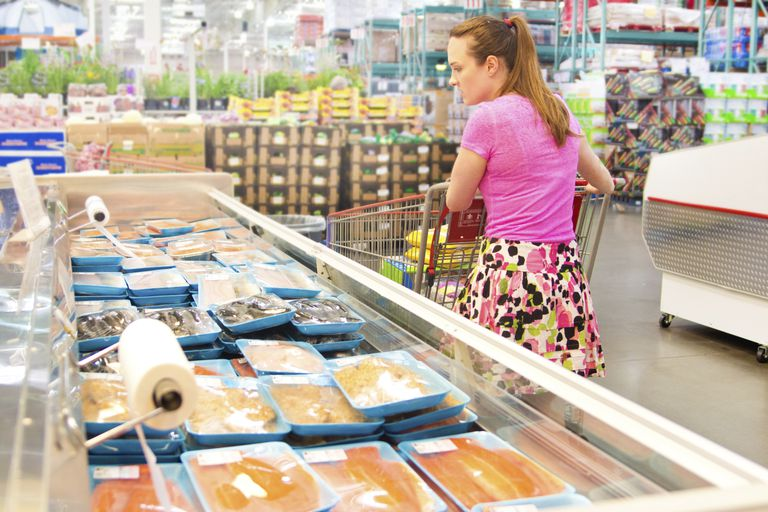 Woman shopping for food to buy in bulk