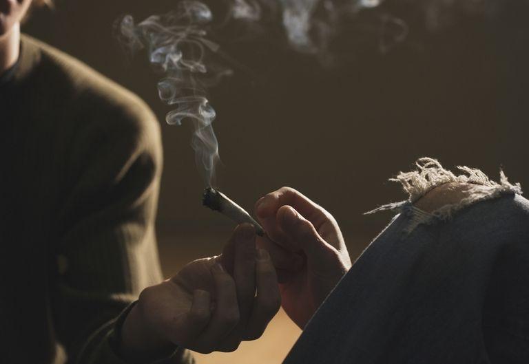Hands Passing Marijuana