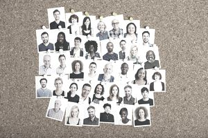 Social Network concept with photographs of people on a board