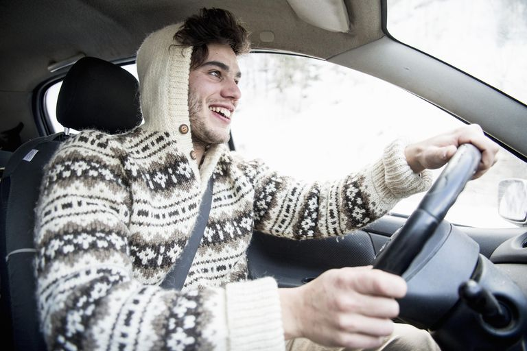 Young man driving in winter