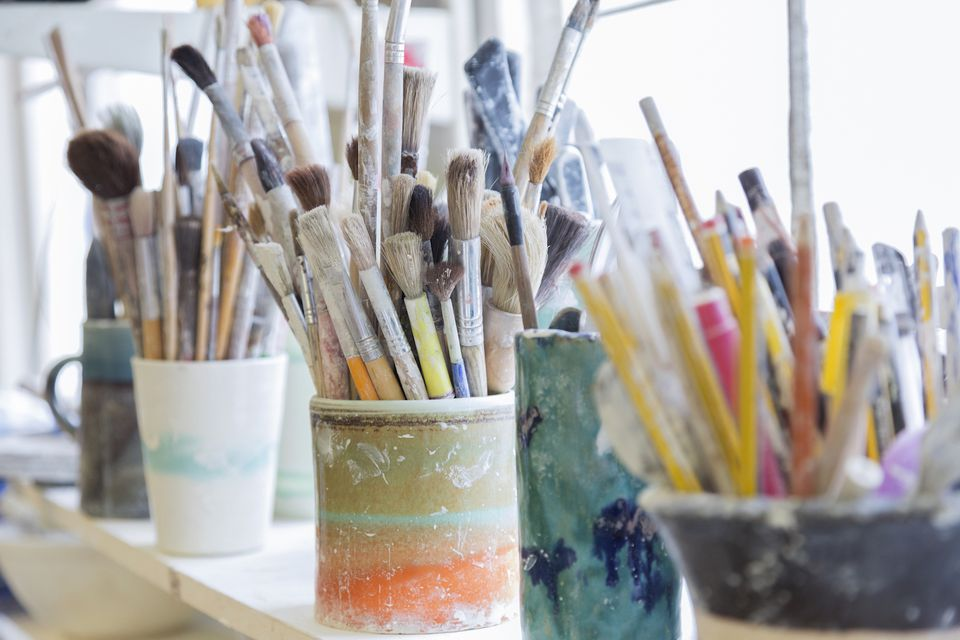 organized craft room paint brushes