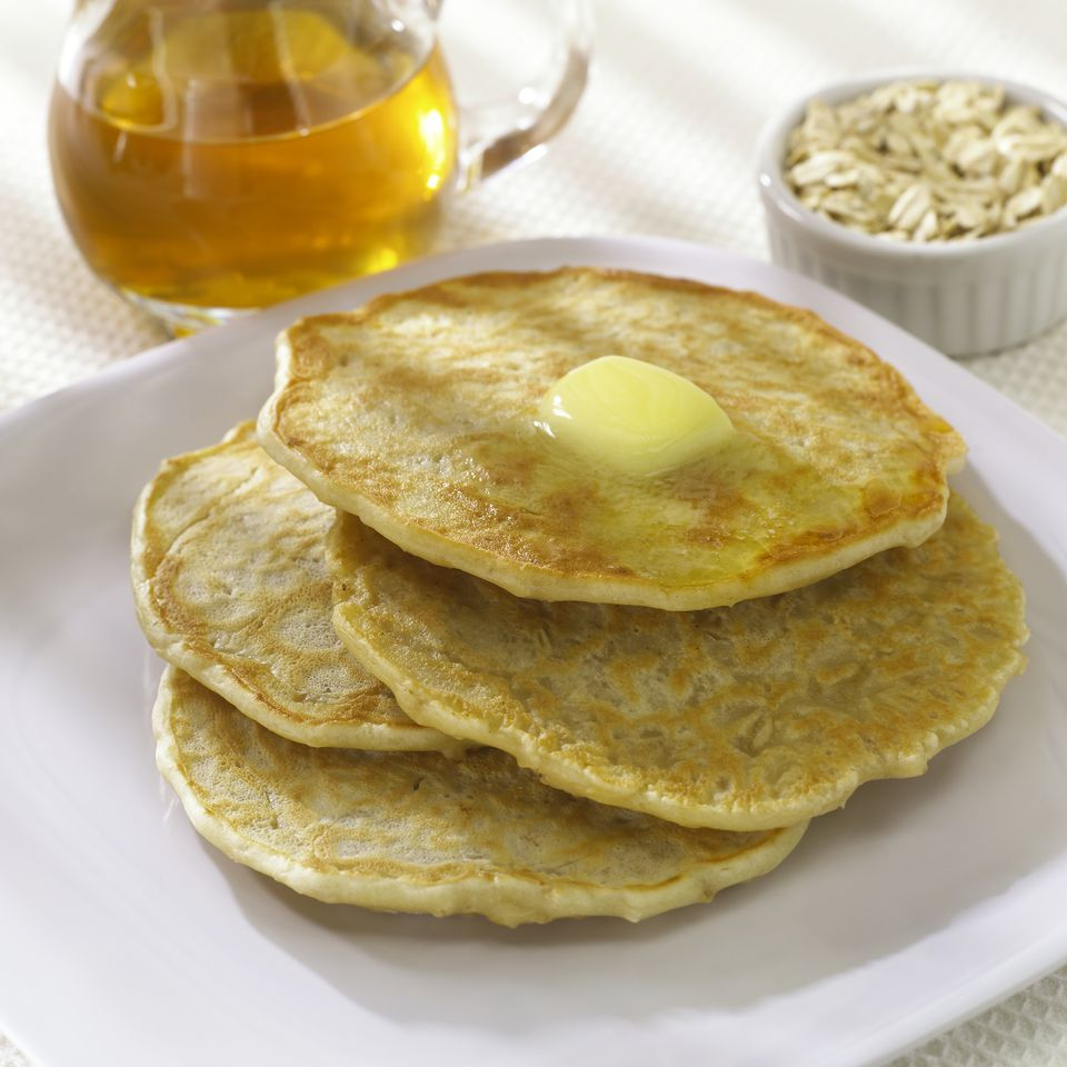 Stack of oatmeal pancakes with butter & syrup
