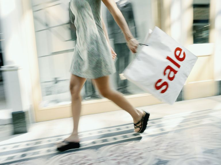 Woman with a sale shopping bag.
