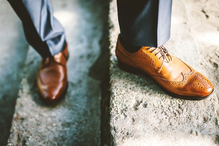 Low Section Of Man With Brogue Shoes Standing On Steps