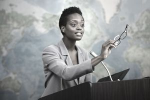 African American businesswoman talking at podium
