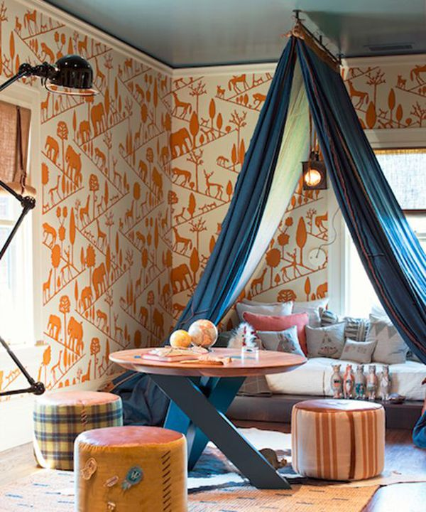 Bohemian boys room with bold wallpaper print and canopy bed
