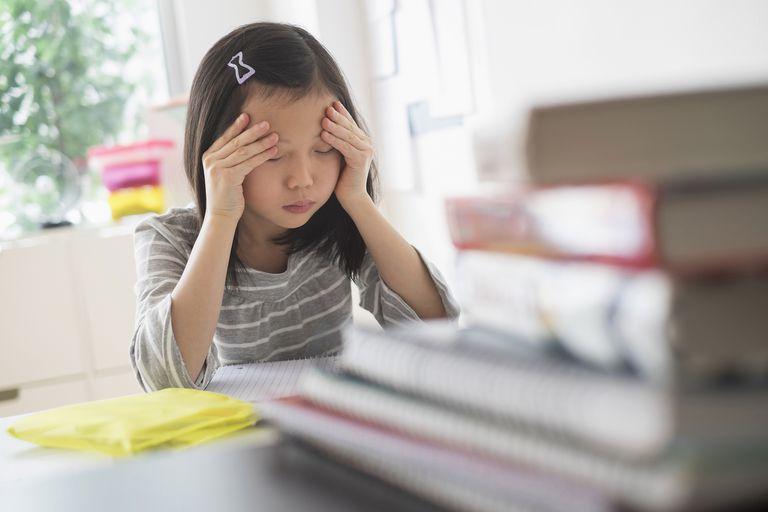 Anxious student rubbing head