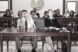 a defendant and his lawyer in a court case