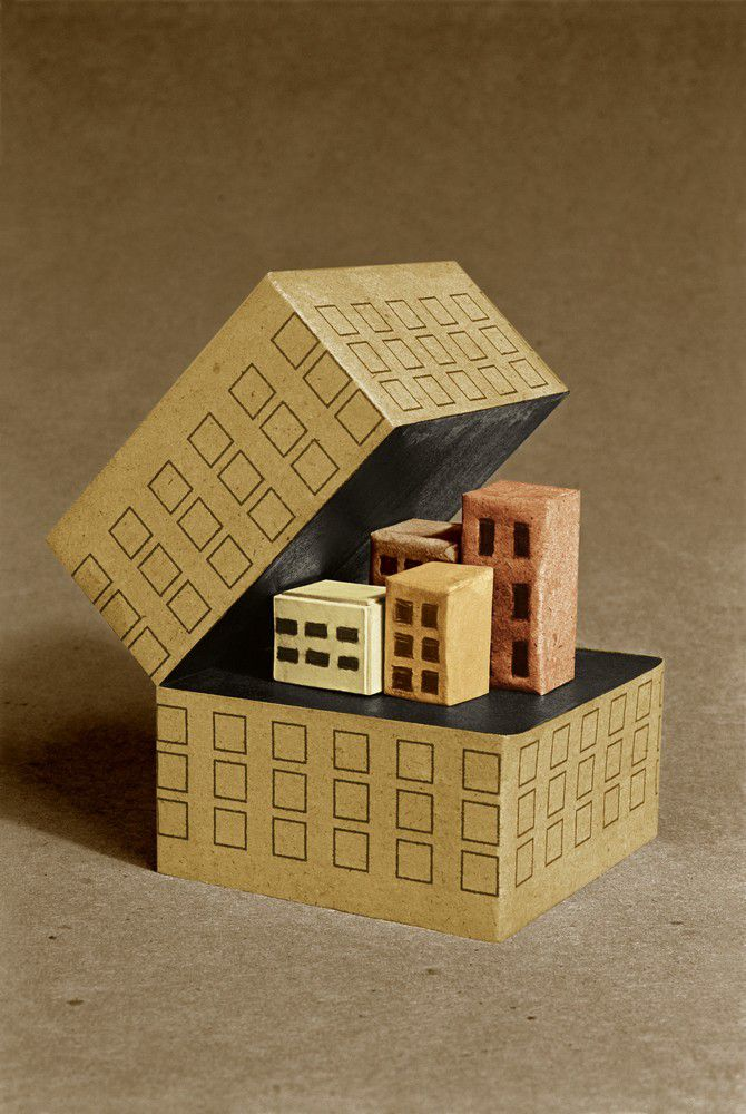Model of several small buildings inside single larger building