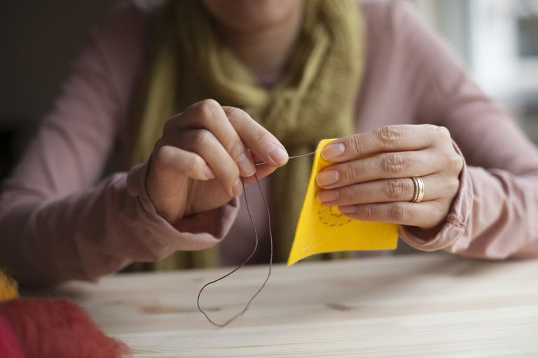 Woman doing needlepoint