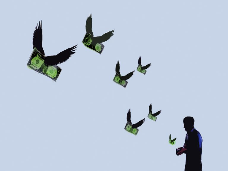 Money with wings flying out of man's wallet